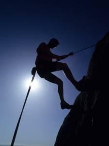 silhouette-of-rock-climber-boulder-colorado-usa